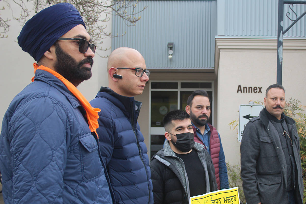 Ishwinder Singh an organizer of the 'Basmodi Wave' (second from left), stands with other organizers and Coun. Jag Gill middle). Singh said the three farm bills being protested would allow a corporate takeover of farming in India. Patrick Penner / Mission Record.