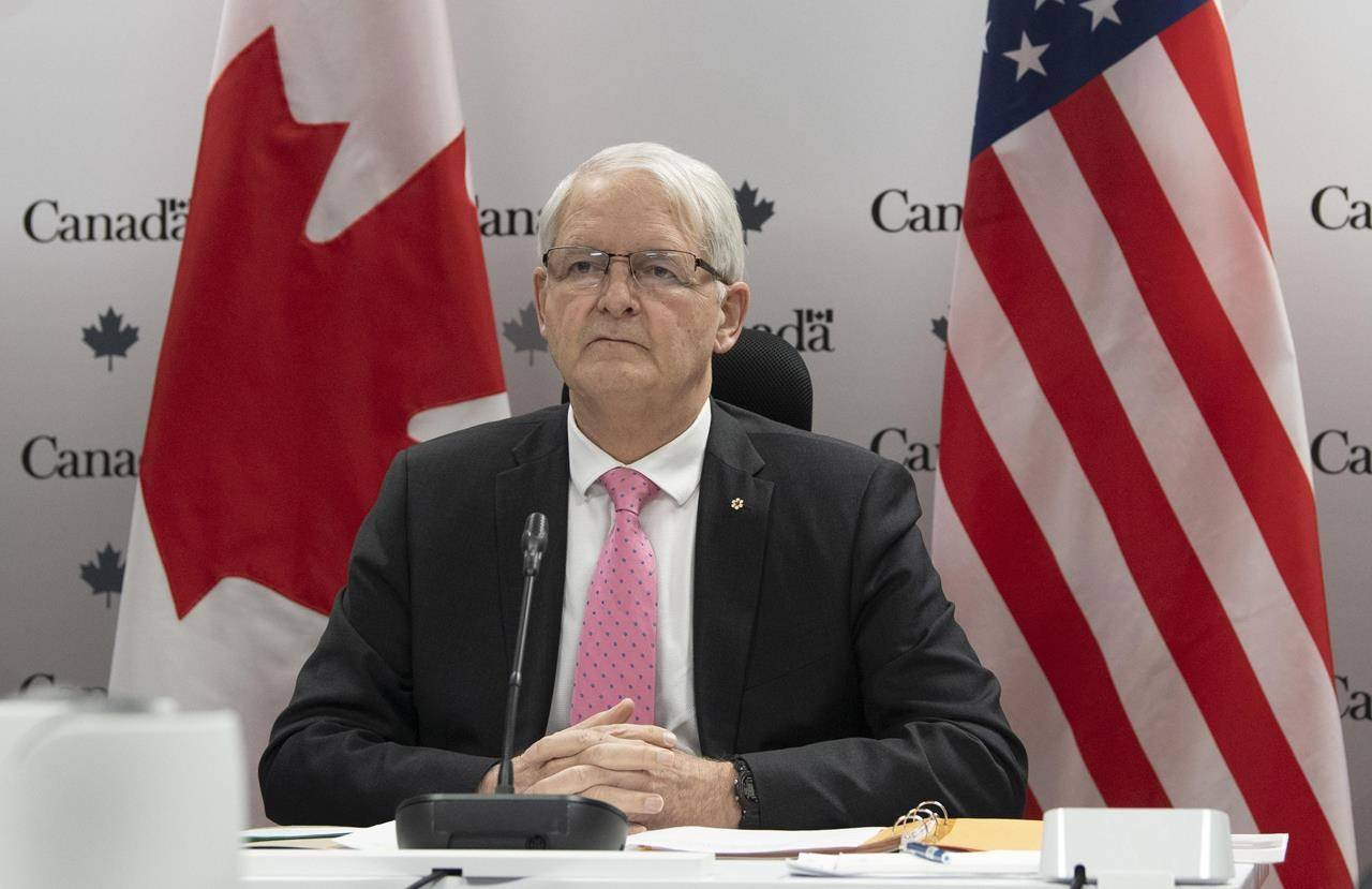 Foreign Affairs Minister Marc Garneau waits for a virtual meeting to begin with U.S. Secretary of State Antony Blinken in Ottawa, Friday Feb. 26, 2021. THE CANADIAN PRESS/Adrian Wyld