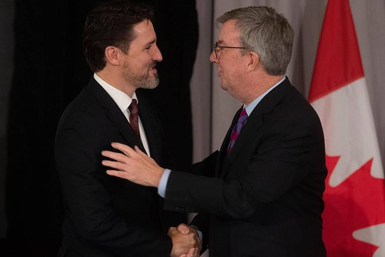 Canadian Prime Minister Justin Trudeau speaks with Ottawa Mayor Jim Watson at the start of a meeting with Mayors of Canada's largest cities in Ottawa on February 6, 2020. THE CANADIAN PRESS/Adrian Wyld