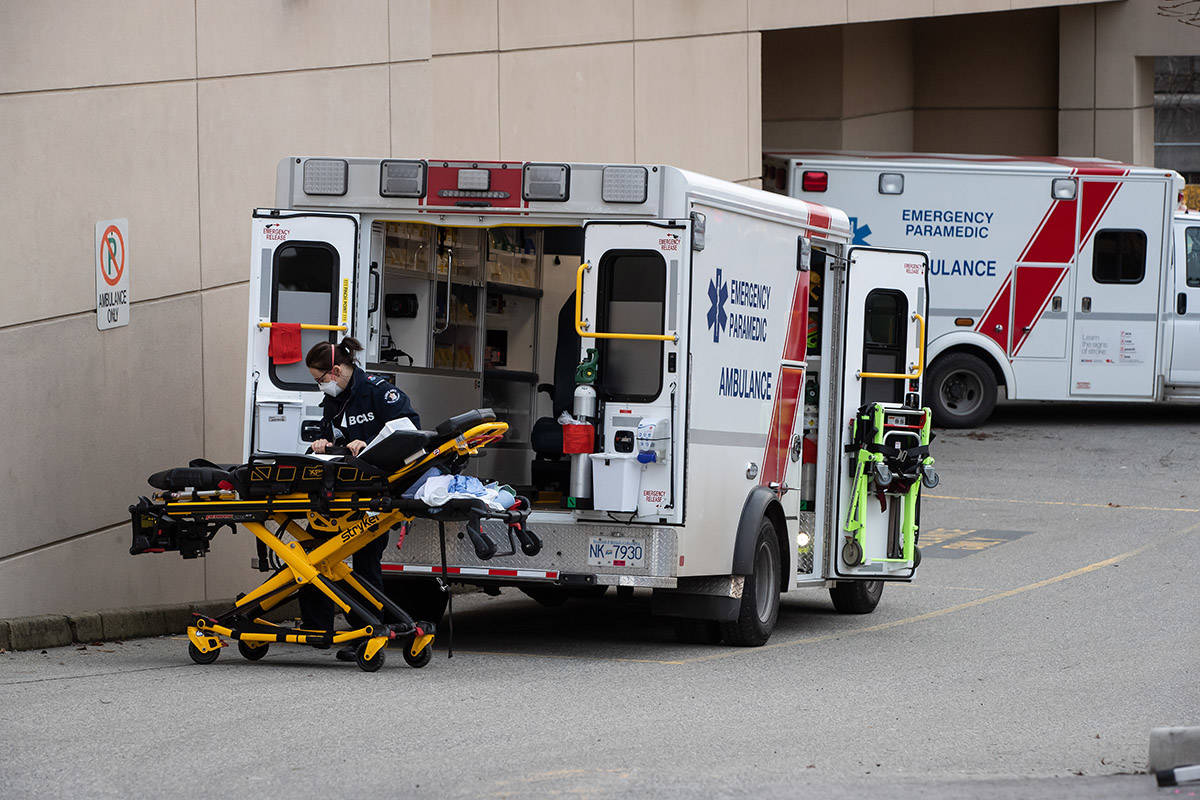 FILE – A B.C. Ambulance Service paramedic wearing a face mask to curb the spread of COVID-19 moves a stretcher outside an ambulance at Royal Columbia Hospital, in New Westminster, B.C., on Sunday, November 29, 2020. THE CANADIAN PRESS/Darryl Dyck
