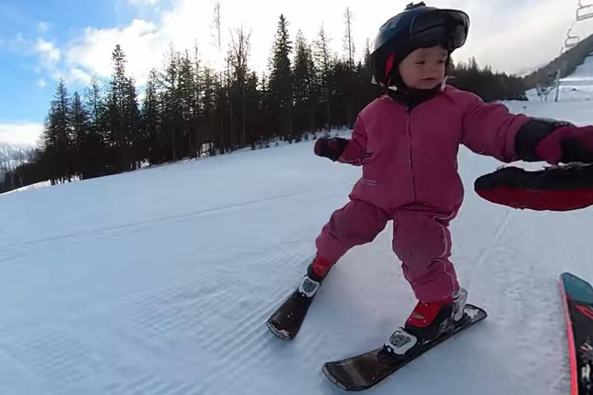 Three-year-old Adia Leidums gives her dad a hi-five at Fernie Alpine Resort. (Image courtesy of Erich Leidums)