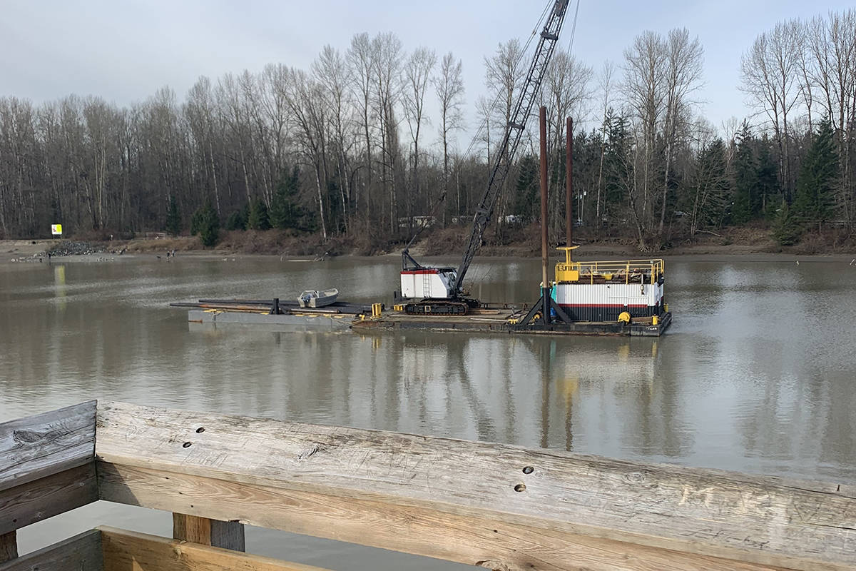 A floating crane moved into position on March 12 to begin work on rebuilding the view platform on the Fort to Fort Trail in Langley (Special to Langley Advance Times)
