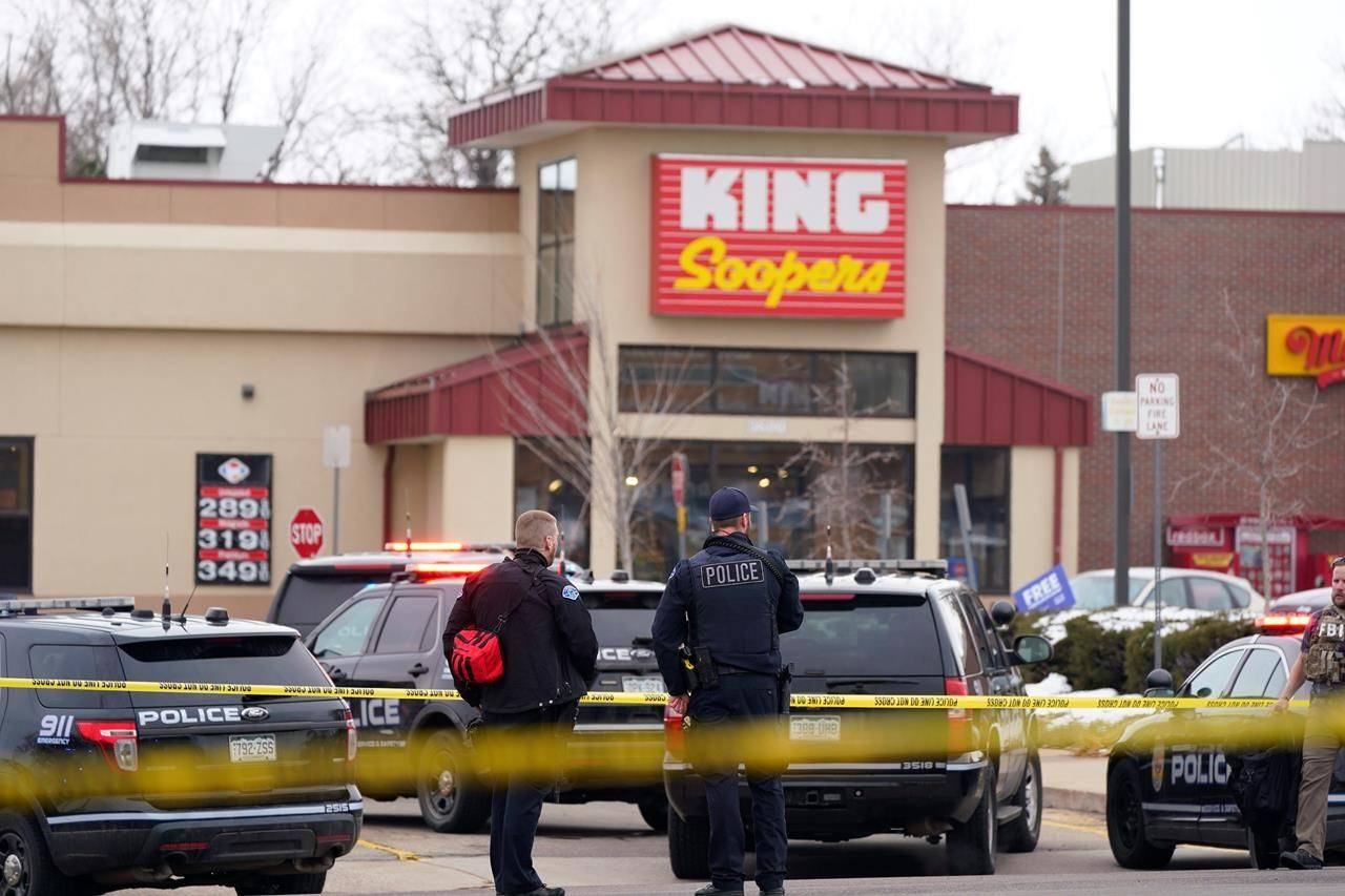 Police stand outside a King Soopers grocery store where a shooting took place, Monday, March 22, 2021, in Boulder, Colo. (AP Photo/David Zalubowski)