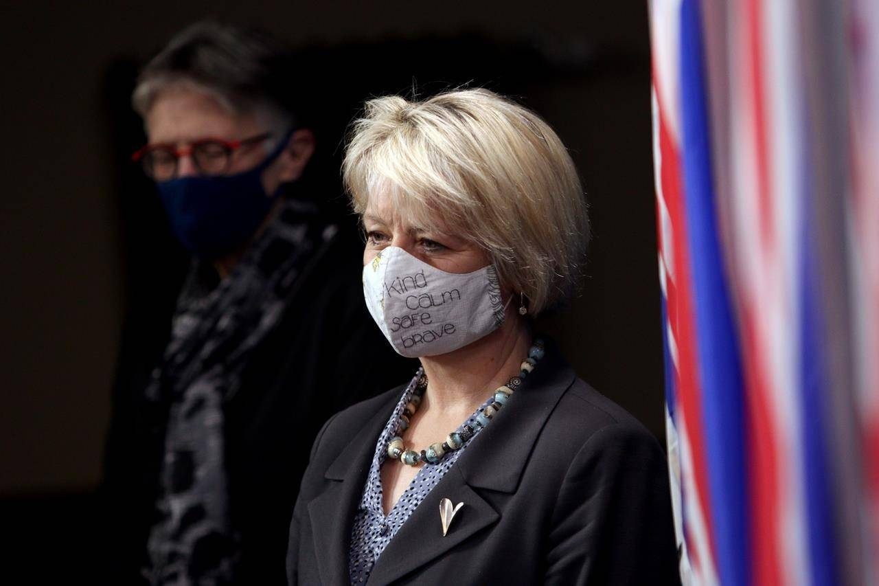 Dr. Bonnie Henry is joined by Dr. Penny Ballem as they arrive to talk about phase 2 in B.C.'s COVID-19 immunization plan at Legislature in Victoria, B.C., on Monday, March 1, 2021. THE CANADIAN PRESS/Chad Hipolito