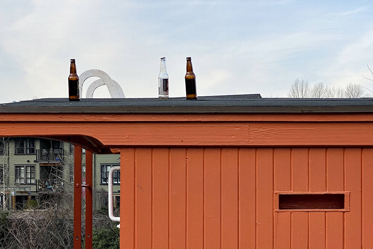 Visitors left bottles behind on the caboose roof at the historic CN station in Fort Langley. Keeping people off the antique rolling stock is a challenge, the station manager said. (Special to Langley Advance Times)