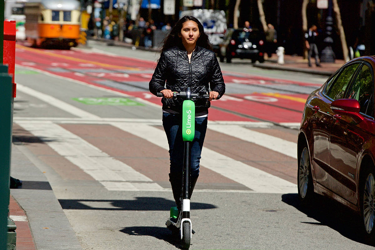 A newly approved provincial pilot project will soon allow electric kick scooters to legally cruise the streets and bike paths of six British Columbia municipalities. (Kevin N. Hume/S.F. Examiner)