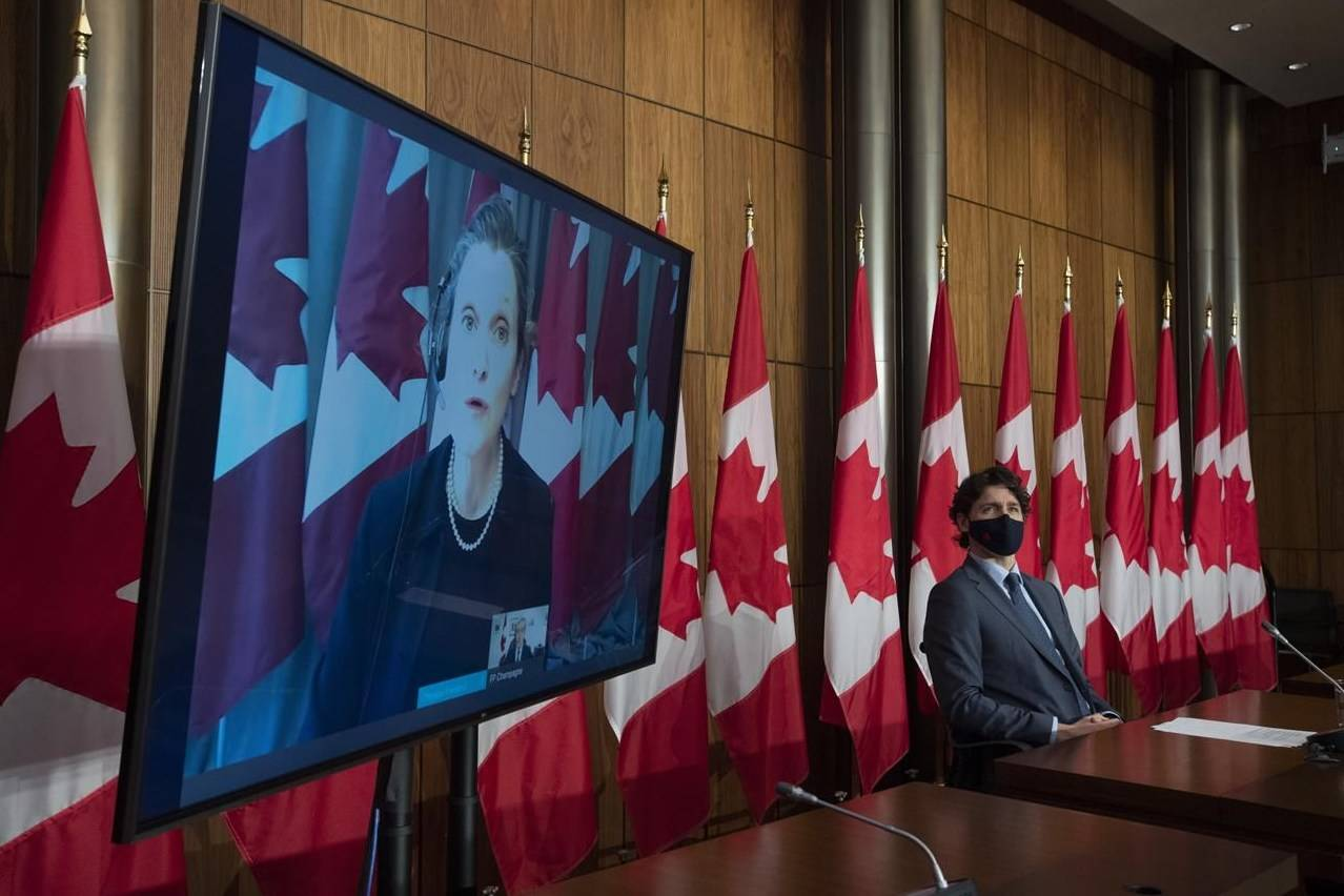 Prime Minister Justin Trudeau listens to Deputy Prime Minister and Minister of Finance Chrystia Freeland speak virtually during a news conference in Ottawa, Wednesday, March 3, 2021. THE CANADIAN PRESS/Adrian Wyld