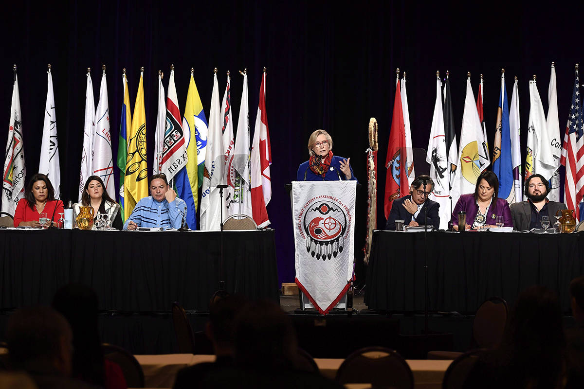 Alberta regional chief Marlene Poitras, left, interim Yukon regional chief Kluane Adamek, and National Chief of the Assembly of First Nations Perry Bellegarde, along with co-chairs Harold Tarbell, Racelle Kooy, and Tim Catcheway, listen as Minister of Crown-Indigenous Relations and Northern Affairs Carolyn Bennett, centre, speaks during the AFN Special Chiefs Assembly in Gatineau, Que., on Tuesday, May 1, 2018. THE CANADIAN PRESS/Justin Tang