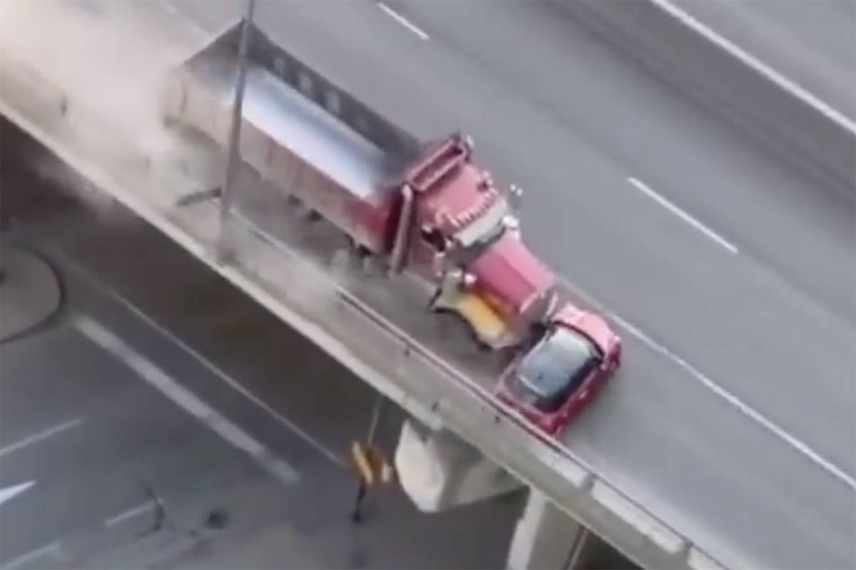 A video posted to Twitter by a Toronto Police Service Traffic Services officer on Wednesday, March 24, 2021, shows a Mini Cooper being pushed by a dump truck along a Toronto expressway. (Scott Matthews/Twitter)