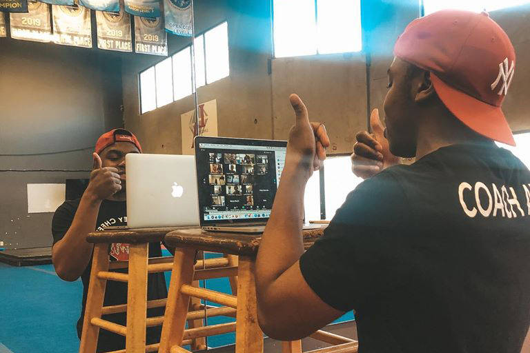 Langley Cheer Athletics Gym Coach Axel Obame put athletes through their paces online in April of 2020. Practices are now allowed in person, but competitions are still virtual. (Sam Farrell/special to Langley Advance Times)