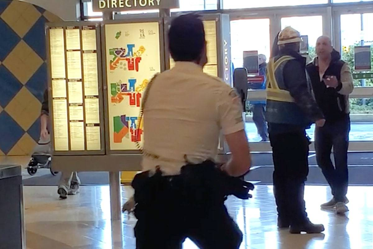 A video of the incident posted on Reddit shows the men standing in line at the McDonald's inside the mall before a fight breaks out. (Screen grab/Reddit)