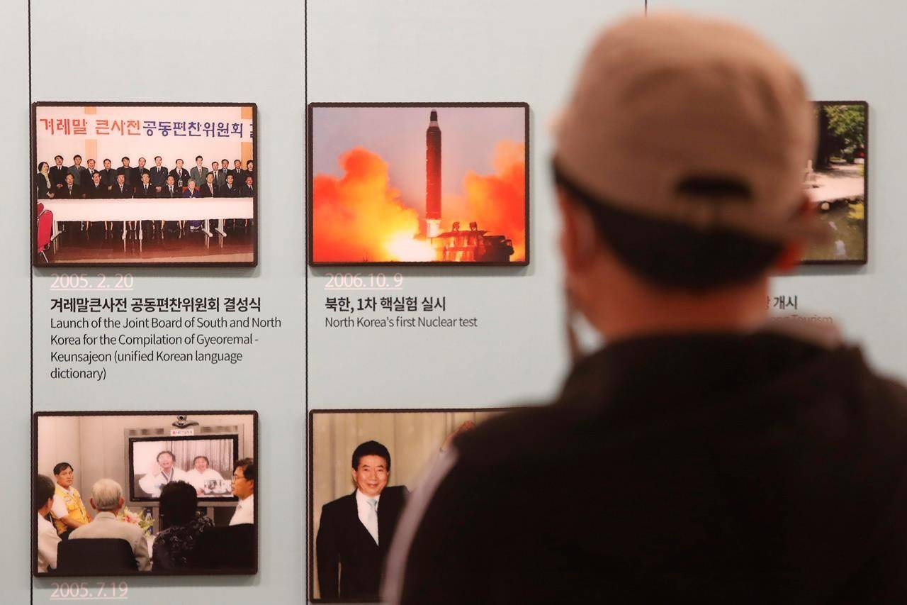 A photo showing North Korea's missile launch is displayed at the Unification Observation Post in Paju, near the border with North Korea, South Korea, Wednesday, March 24, 2021. North Korea fired short-range missiles this past weekend, just days after the sister of Kim Jong Un threatened the United States and South Korea for holding joint military exercises. (AP Photo/Ahn Young-joon)