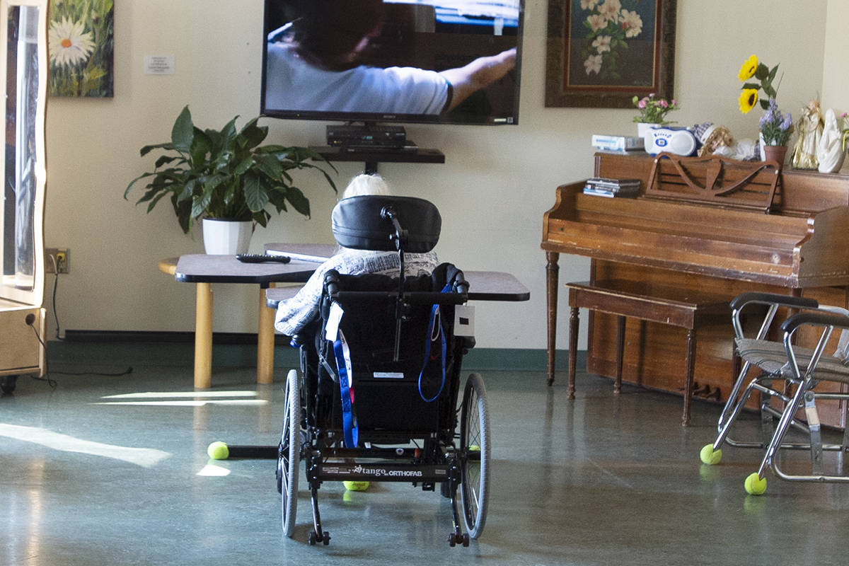 A resident watches television at CHSLD Rose-de-Lima seniors residence Friday, March 12, 2021 in Laval, Quebec. Almost all of the residents in Quebec senior residences have received at least their first Covid-19 vaccination shot.THE CANADIAN PRESS/Ryan Remiorz