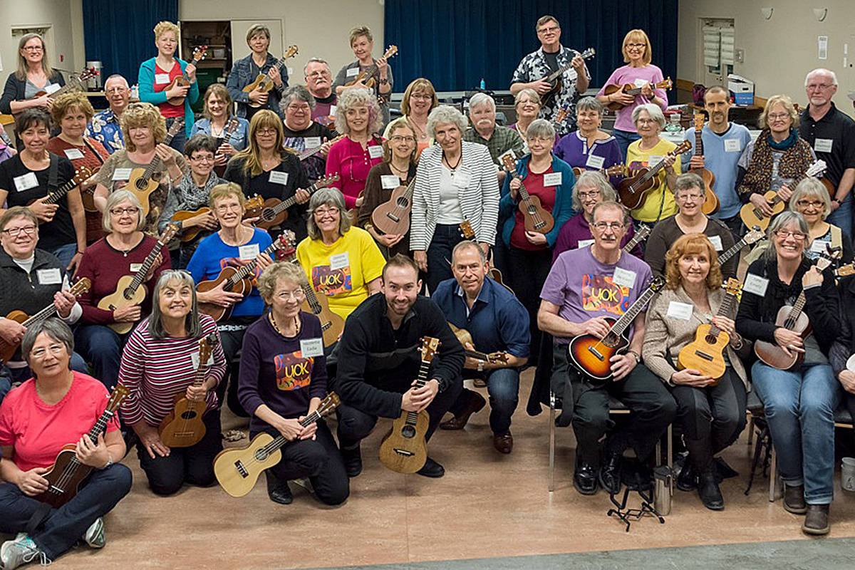 Paul and Peter Luongo (centre) love sharing their passion for the ukulele with music students of all ages. (Special to Langley Advance Times)