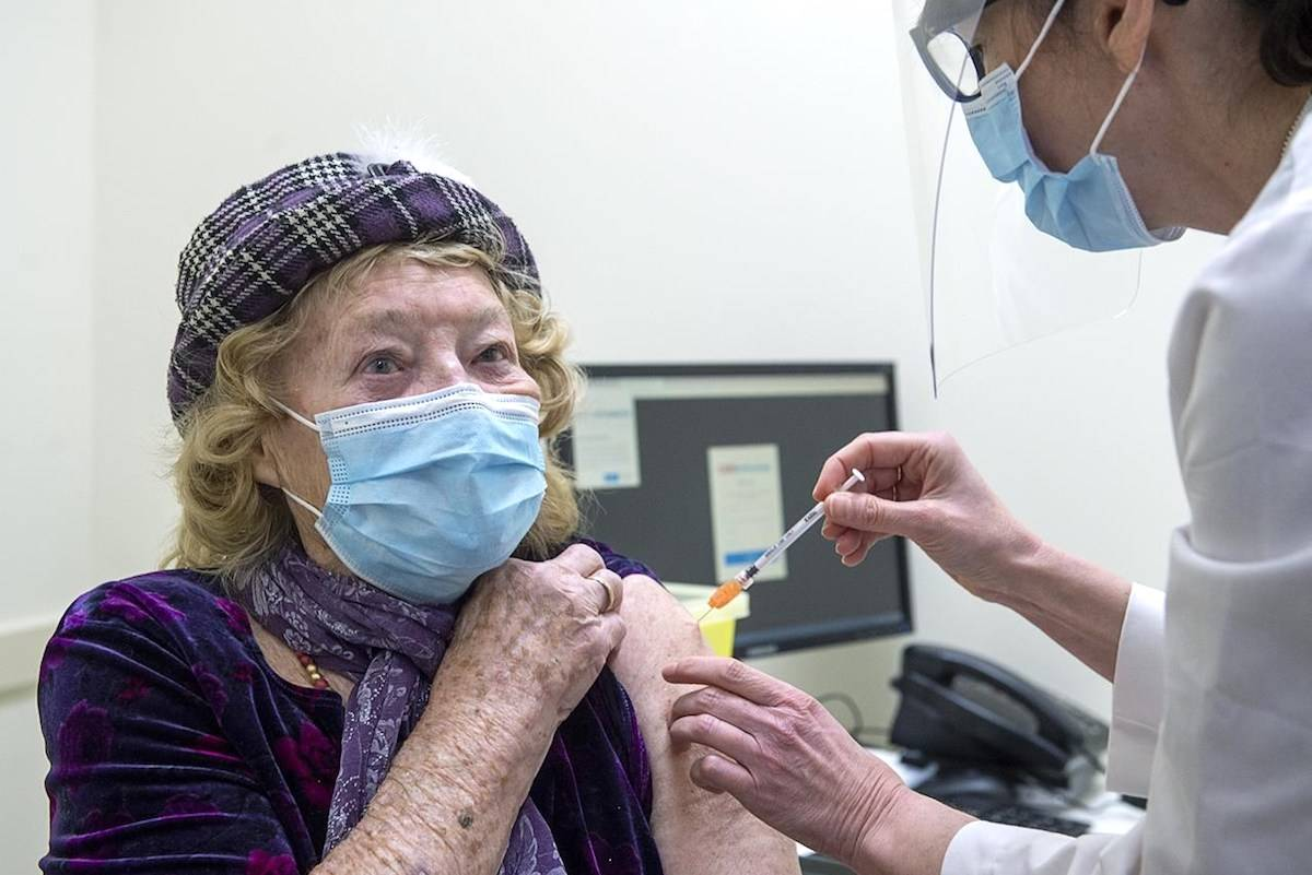 Jeanne Hennebury, 93, receives the Pfizer-BioNTech COVID-19 mRNA vaccine from Vena Anderson at a pharmacy prototype clinic in Halifax on Tuesday, March 9, 2021. CANADIAN PRESS/Andrew Vaughan