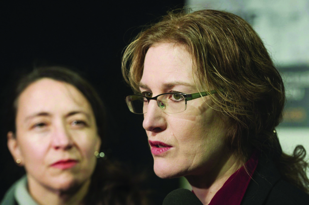 Polytechnique survivors Heidi Rathjen, right, and Nathalie Provost speak to the media following an announcement of details of Quebec's long gun registry by Quebec Public Security Minister Martin Coiteux during a news conference in Montreal, Sunday, January 28, 2018. THE CANADIAN PRESS/Graham Hughes