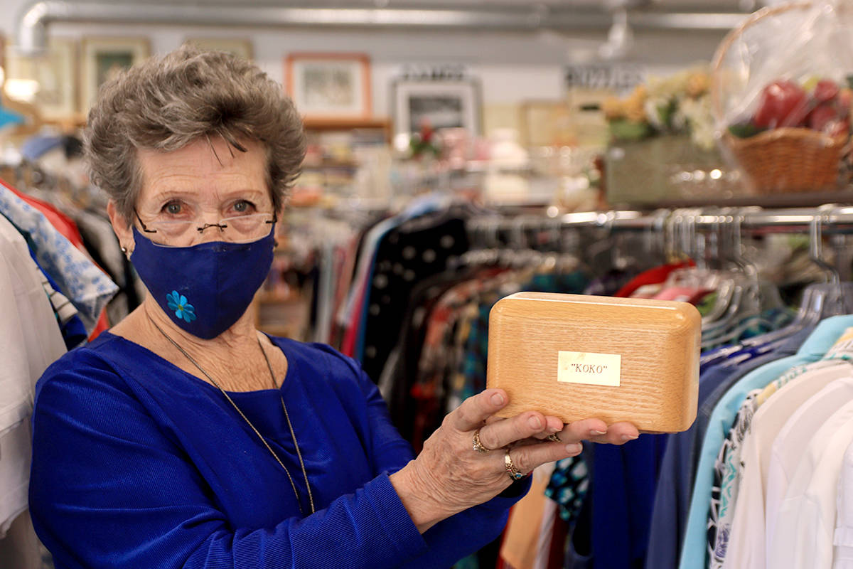 "Grand Forks' Lenora ""Jo"" Belazs holds up a box thought to contain the ashes of ""Koko,"" left at the Boundary Hospital Auxiliary Thrift Shop on Wednesday, March 24. Photo: Laurie Tritschler"