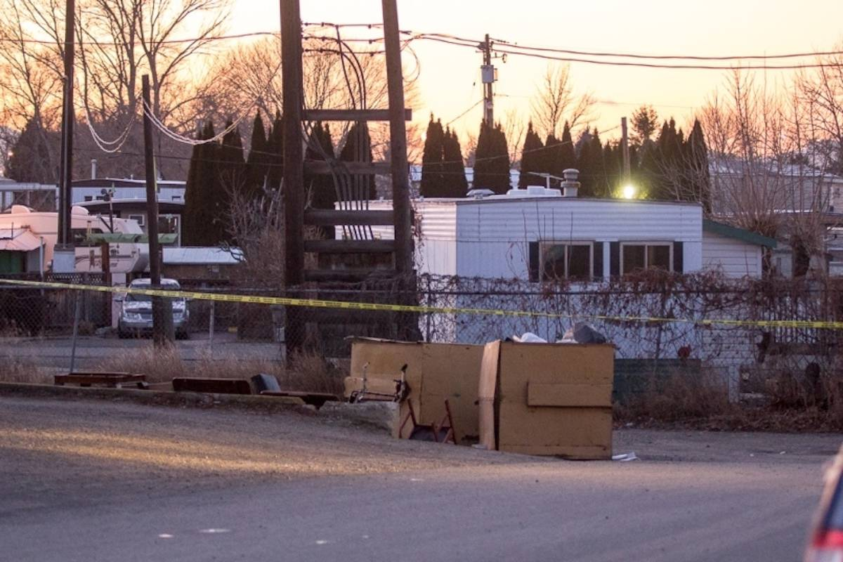 Police tape surrounded the apartment building at 170 Carson Cres., where David Boltwood's body was found in the alleyway behind the building on the morning of Nov. 29, 2019. (Kamloops This Week)