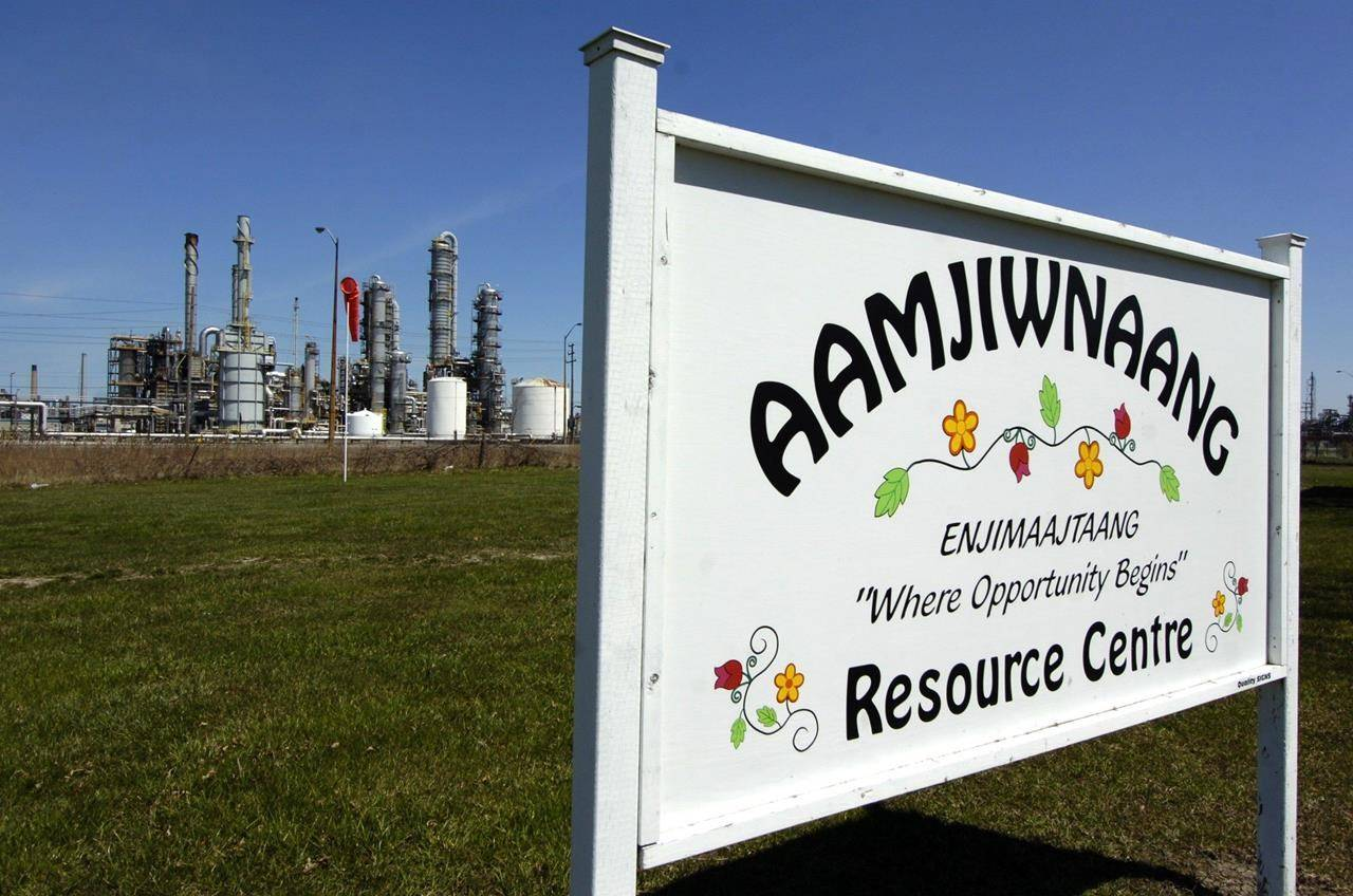 A sign for the Aamjiwnaang First Nation Resource Centre is located across the road from NOVA Chemicals in Sarnia, Ontario on April 21, 2007. THE CANADIAN PRESS/Craig Glover