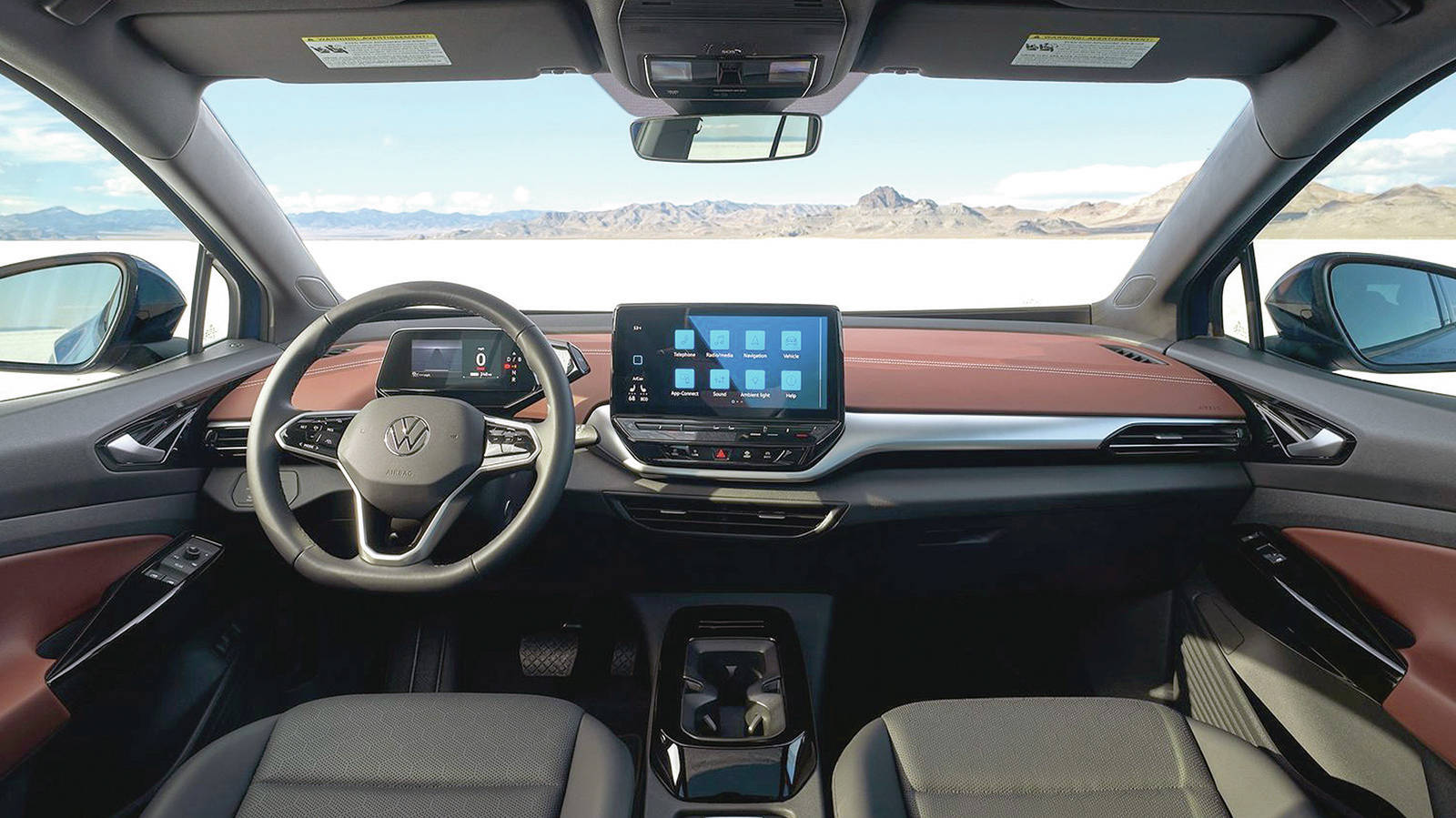The dash layout is incredibly simple and tidy. There's a standard 10-inch centre display and a smaller one for the gauge package. The direction changer — it's not really a gear selector — is located next to it. PHOTO: VOLKSWAGEN