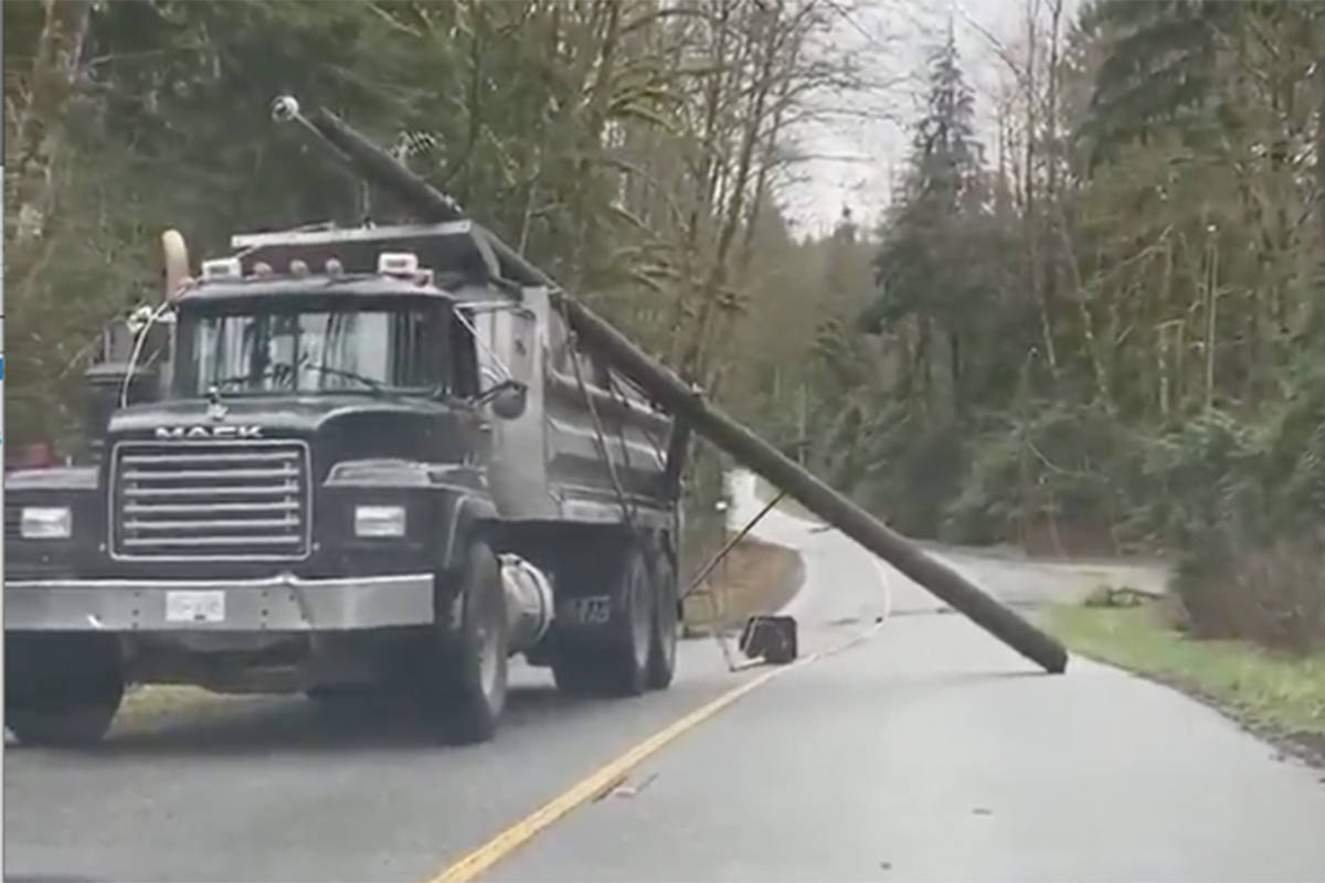 A video posted to social media appeared to show a truck dragging a power pole down the road toward oncoming traffic (Facebook image)