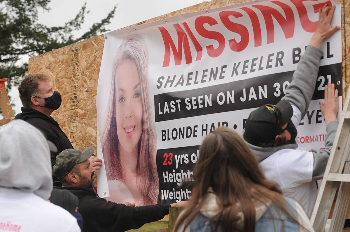 Friends and family members of Shaelene Keeler Bell help hang a banner along Highway 1 in Abbotsford near Bradner Road on Saturday, March 27, 2021. Bell of Chilliwack was last seen on Jan. 30, 2021. (Jenna Hauck/ Chilliwack Progress)