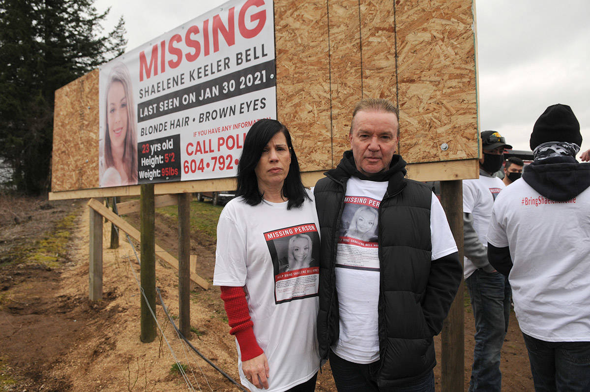 Alina and Kevin Durham, Shaelene Bell's mother and step-father, stand in front of the banner in Abbotsford near Bradner Road on Saturday, March 27, 2021. (Jenna Hauck/ Chilliwack Progress)