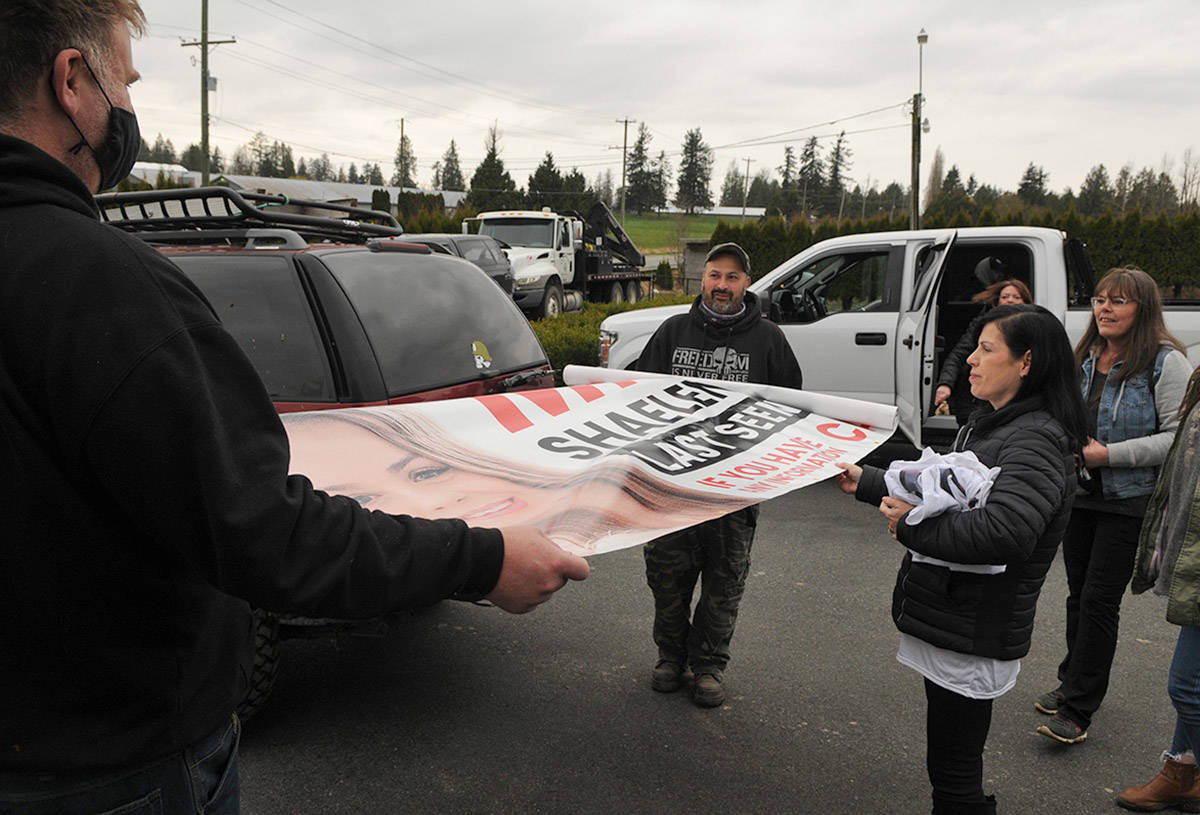 Alina Durham (right) looks at the 16-by-four-foot banner with her daughter's face on it. Shaelene Keeler Bell of Chilliwack was last seen on Jan. 30, 2021. (Jenna Hauck/ Chilliwack Progress)
