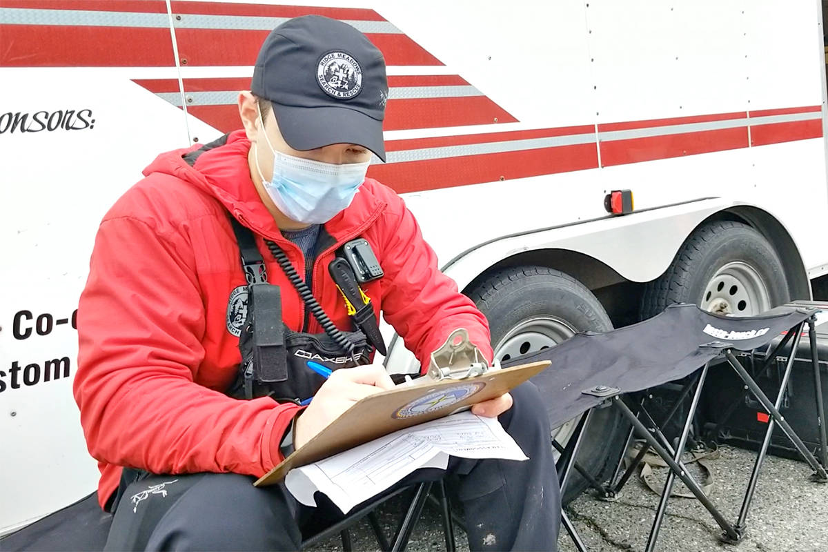 A searcher fills out a report following a sweep on Saturday, March 27, of a Walnut Grove park for a missing Langley teen, who was reported safe and sound on Sunday (Dan Ferguson/Langley Advance Times)