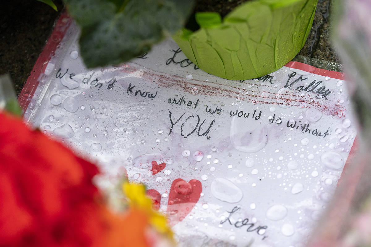 Flowers and notes are seen at a makeshift memorial outside of the Lynn Valley Library in North Vancouver, B.C., Sunday, March 28, 2021. The memorial is for stabbing victims that were attacked by a man with a knife on Saturday, sending several to hospital and leaving one dead. THE CANADIAN PRESS/Jonathan Hayward