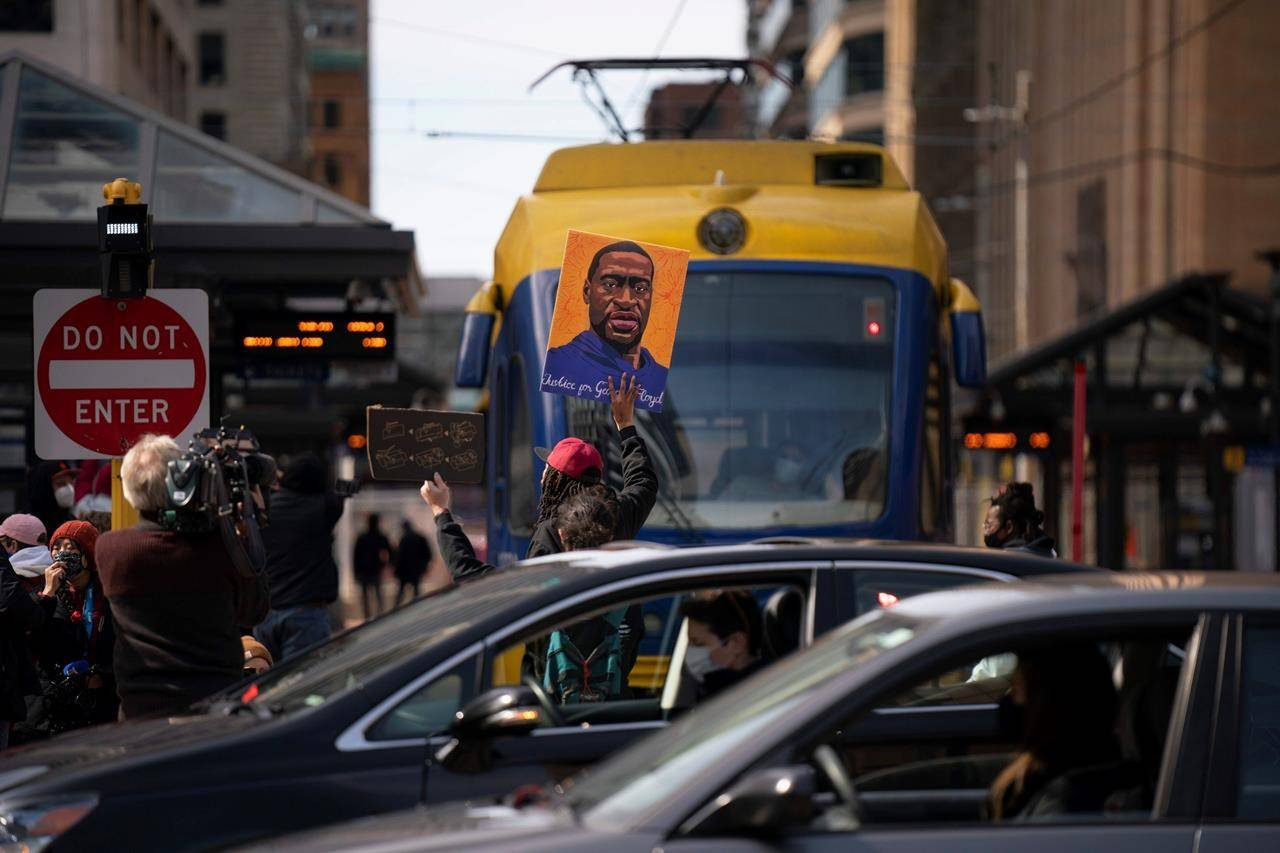 A light rail train is blocked briefly by demonstrators next to the plaza at Hennepin County Government Center on the eve of the start of the trial of Derek Chauvin in the killing of George Floyd, Sunday, March 28, 2021, in Minneapolis. (Jeff Wheeler/Star Tribune via AP)