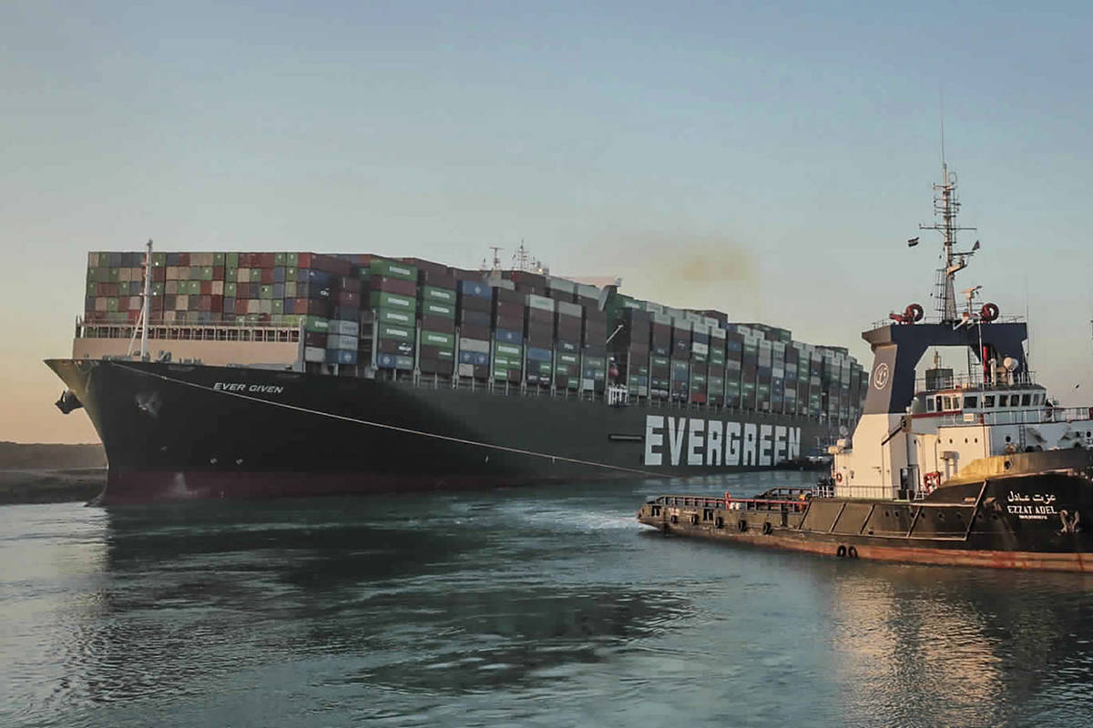 "In this photo released by Suez Canal Authority, the Ever Given, a Panama-flagged cargo ship, is pulled by one of the Suez Canal tugboats, in the Suez Canal, Egypt, Monday, March 29, 2021. Engineers on Monday ""partially refloated "" the colossal container ship that continues to block traffic through the Suez Canal, authorities said, without providing further details about when the vessel would be set free. (Suez Canal Authority via AP)"