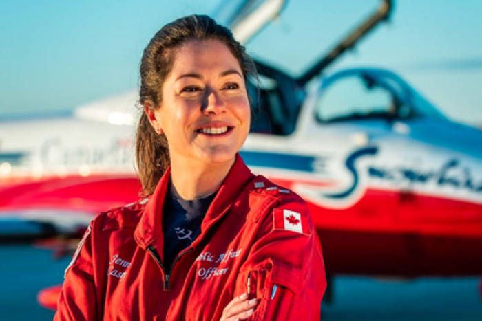 """The Royal Canadian Air Force has this photo of Capt. Jenn Casey pinned to its twitter account, with the following message: """"The RCAF has suffered another tragic loss of a dedicated member of the RCAF team. We are deeply saddened and grieve alongside Jenn's family and friends. Our thoughts are also with the loved ones of Captain MacDougall. We hope for a swift recovery from his injuries. - Comd RCAF"""""""