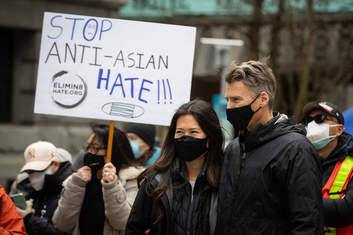 Korean-American journalist Eileen Park, left, and her husband, former Vancouver mayor Gregor Robertson attend a rally opposing discrimination against Asian communities and to mourn the victims of those affected by the Atlanta shootings, in Vancouver, B.C., on Sunday, March 28, 2021. THE CANADIAN PRESS/Darryl Dyck