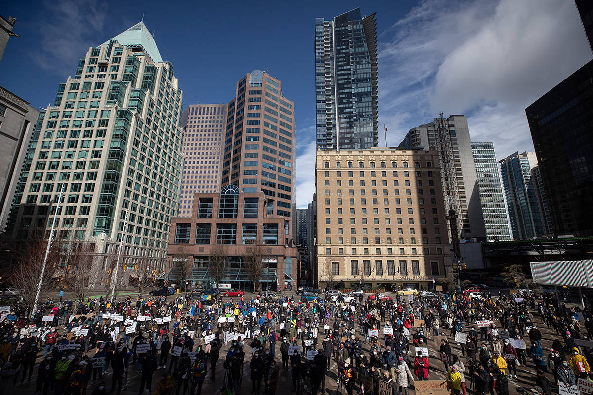 Hundreds of people gather for a rally opposing discrimination against Asian communities and to mourn the victims of those affected by the Atlanta shootings, in Vancouver, B.C., on Sunday, March 28, 2021. THE CANADIAN PRESS/Darryl Dyck