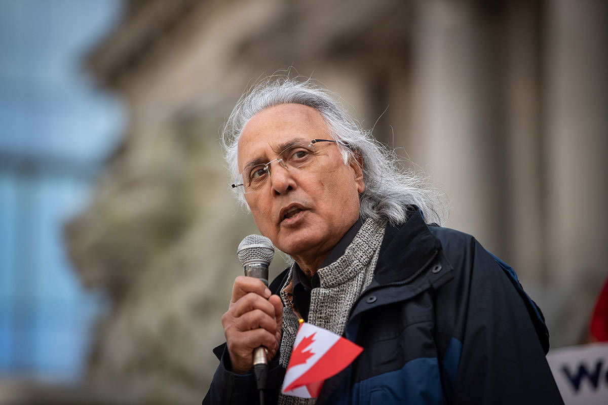 Former British Columbia premier Ujjal Dosanjh addresses the crowd during a rally opposing discrimination against Asian communities and to mourn the victims of those affected by the Atlanta shootings, in Vancouver, B.C., on Sunday, March 28, 2021. THE CANADIAN PRESS/Darryl Dyck