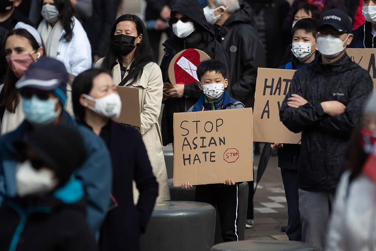 A young boy holds a sign during a rally opposing discrimination against Asian communities and to mourn the victims of those affected by the Atlanta shootings, in Vancouver, B.C., on Sunday, March 28, 2021. THE CANADIAN PRESS/Darryl Dyck