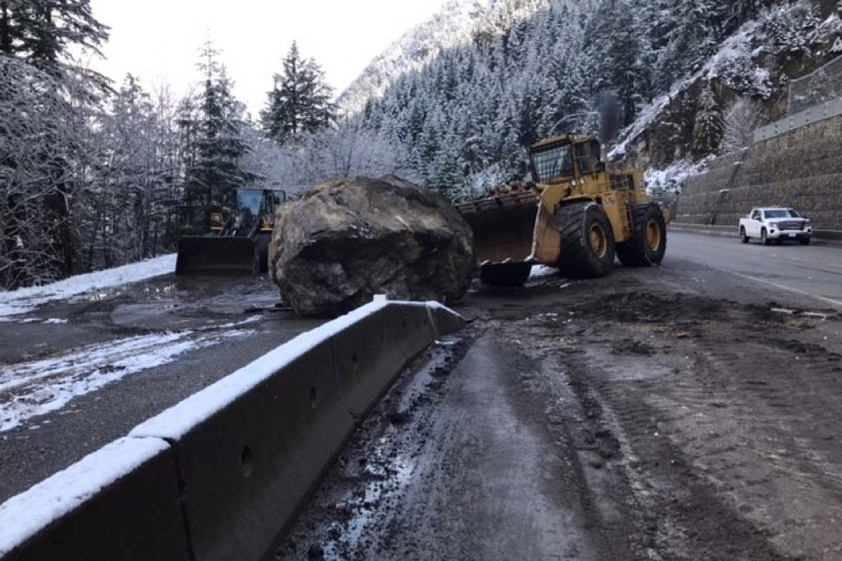 B.C. Transportation crews push a boulder off Highway 1 near Hell's Gate on Monday morning. Traffic through Boston Bar and beyond was backed up throughout most of the morning heading into early afternoon. (Photo/B.C. Transportation)
