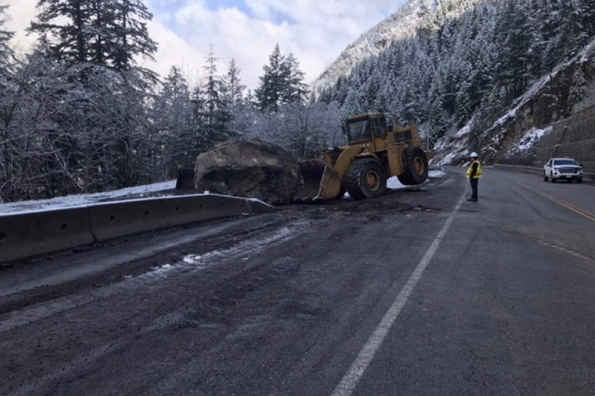 A loader's back tires lift from the pavement as B.C. Transportation crews work to clear a rockslide from Highway 1 outside of Boston Bar on Monday morning. (Photo/B.C. Transportation)