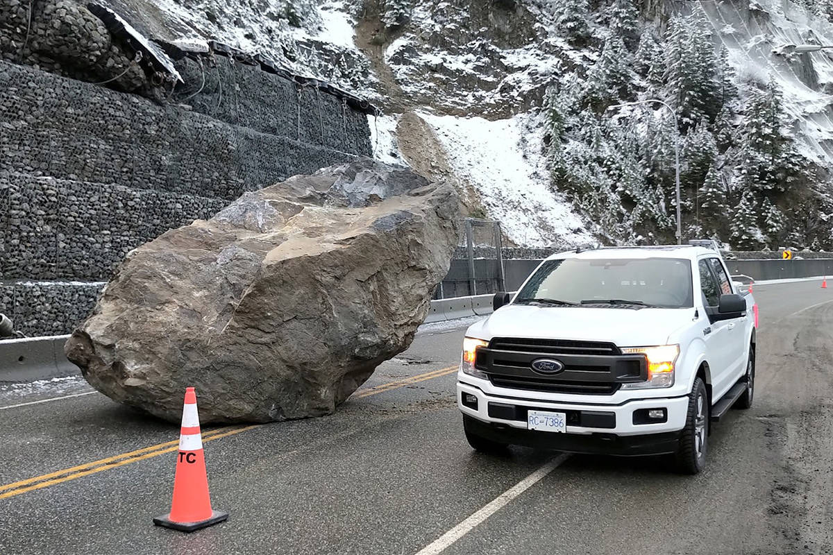 The boulder that blocked off Highway 1 near Hell's Gate on Monday morning. Traffic resumed travel just before noon. (Photo/Emil Anderson Maintenance)