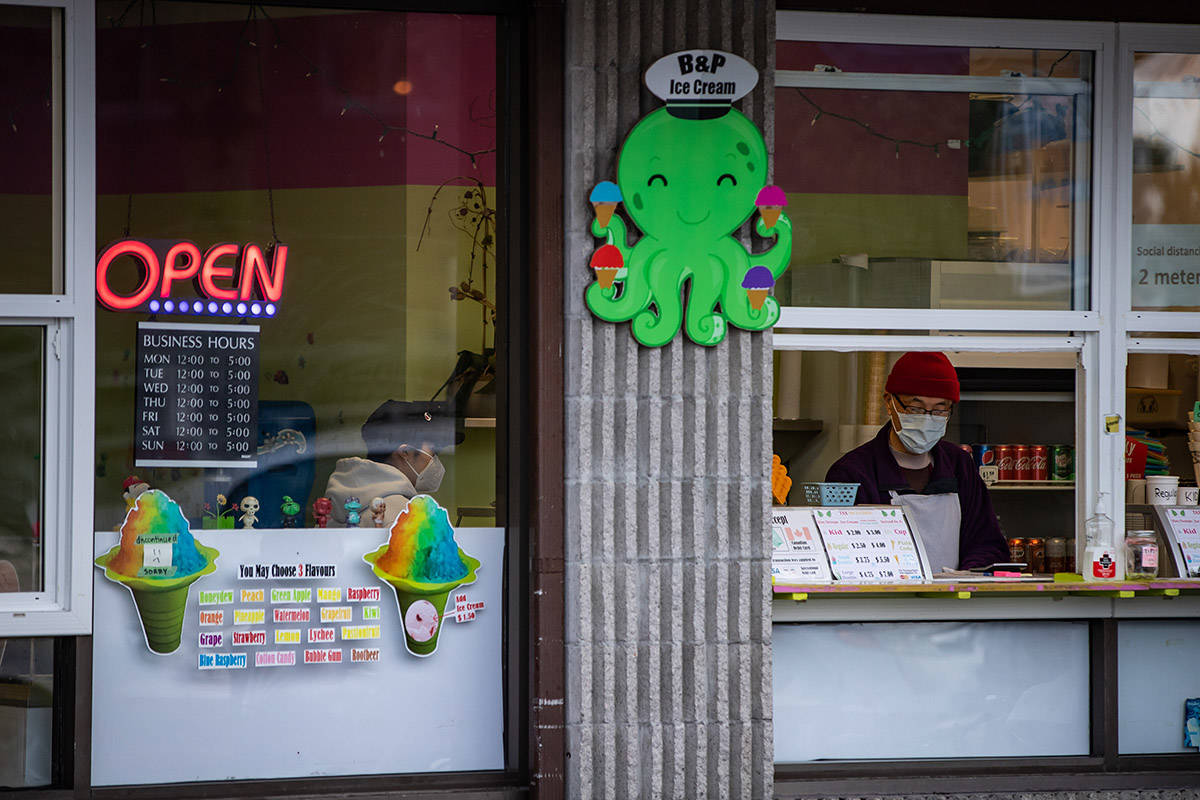 Workers at an ice cream shop wear face masks to curb the spread of COVID-19 at Steveston Village, in Richmond, B.C., on Sunday, January 10, 2021. THE CANADIAN PRESS/Darryl Dyck