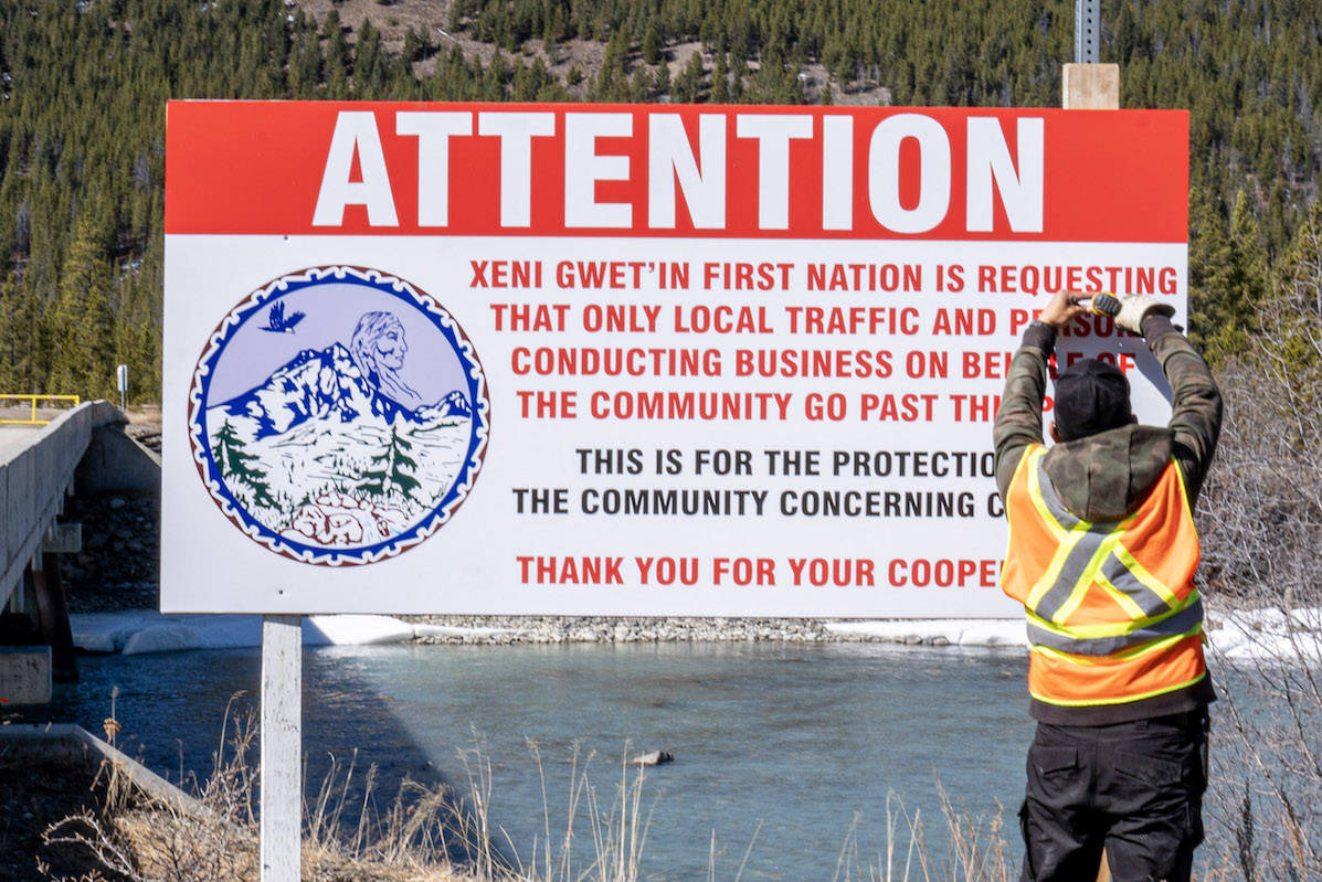 A community member posts a COVID-19 notice at a checkpoint on the Tsilhqot'in Nation in B.C.'s Interior. Many Indigenous communities have controlled their borders in the pandemic. (Keith Koepke/Tsilhqot'in Nation)