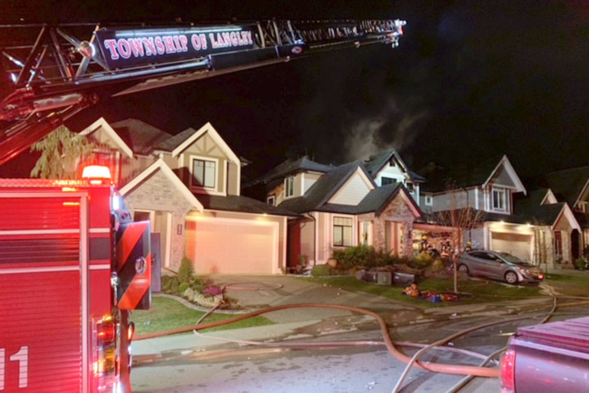 Firefighters were dispatched to a Willoughby home at 86th Avenue and 205B Street just before 1 a.m. on Wednesday, March 31, 2021. (Andy Hewitson/Special to Langley Advance Times)