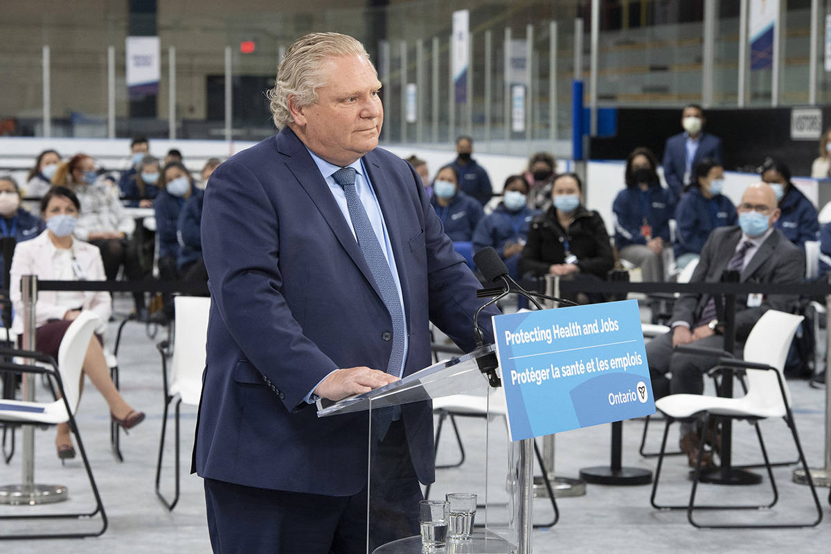Ontario Premier Doug Ford listens to a question during the daily briefing at a mass vaccination centre in Toronto on Tuesday, March 30, 2021. THE CANADIAN PRESS/Frank Gunn