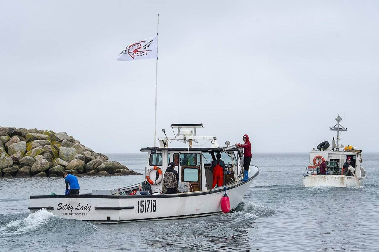 Indigenous lobster boats head from the harbour in Saulnierville, N.S., on Wednesday, Oct. 21, 2020. THE CANADIAN PRESS /Andrew Vaughan