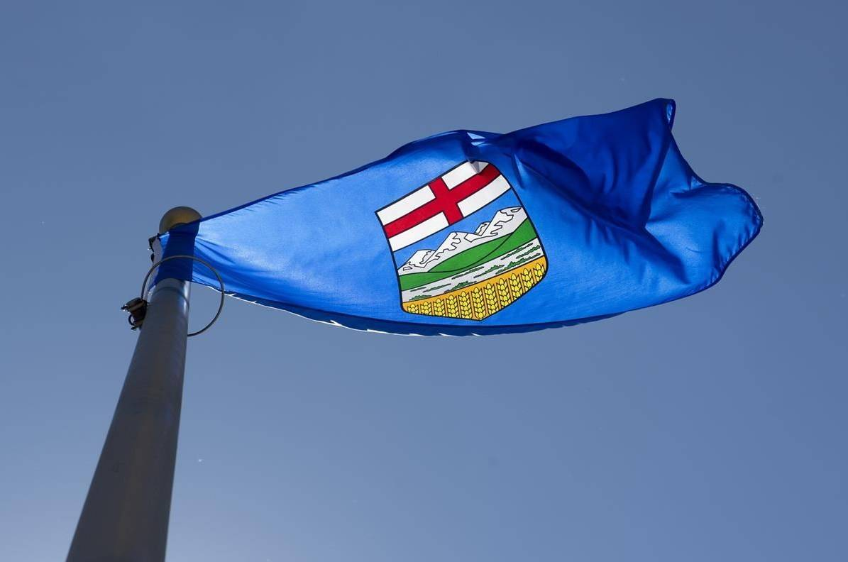 Alberta's provincial flag flies in Ottawa, Monday, July 6, 2020. Alberta is the second province to bring in a law that could help people at risk of domestic violence learn about an intimate partner's criminal record. THE CANADIAN PRESS/Adrian Wyld