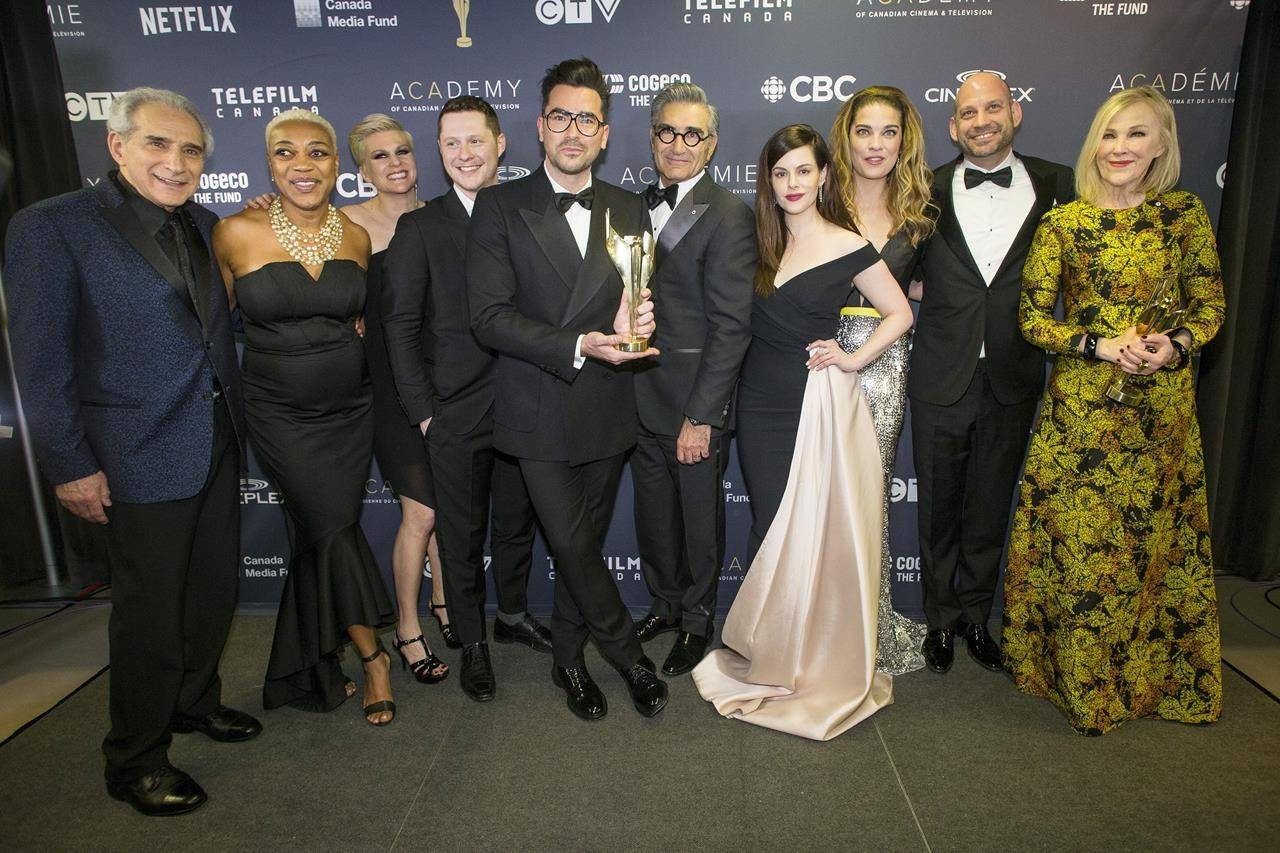 "The cast of ""Schitt's Creek"" pose for a photo after winning the Award for Best Comedy Series at the Canadian Screen Awards in Toronto on March 31, 2019. THE CANADIAN PRESS/Chris Young"