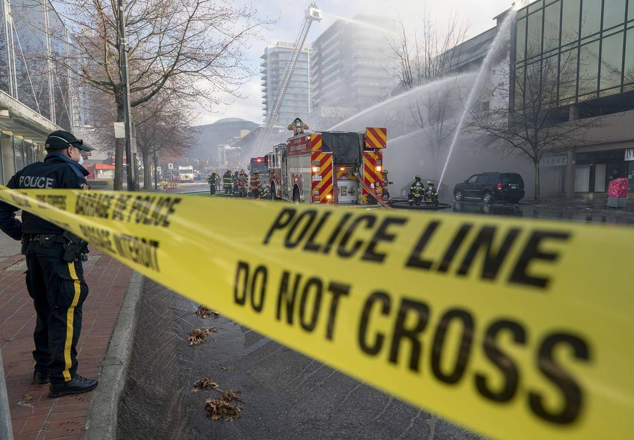 Fire fighters attend a fire at a Masonic Temple in North Vancouver, B.C., Tuesday, March 30, 2021. THE CANADIAN PRESS/Jonathan Hayward