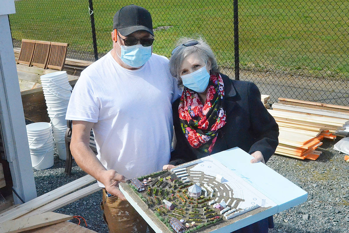 Tim and Janet Kreiter with a model Tim built showing the eventual plan for a five to 10 acre community garden the couple hopes to create in Langley. A pilot project is running this spring at TWU. (Matthew Claxton/Langley Advance Times)