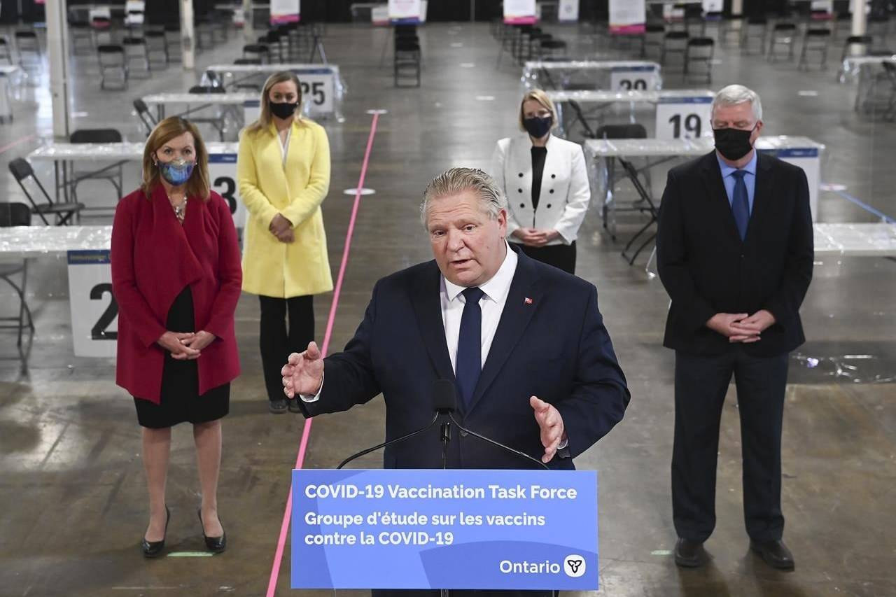 Ontario Premier Doug Ford answers questions from the media at a COVID-19 mass vaccination clinic in Toronto, Wednesday, March 10, 2021. Ontario is expected to announce new public health restrictions to address surging COVID-19 case rates. THE CANADIAN PRESS/Nathan Denette